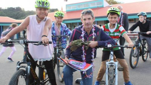 Karl Woolcott of RIDE holidays made some kids at Taita Central School very happy with free school bikes